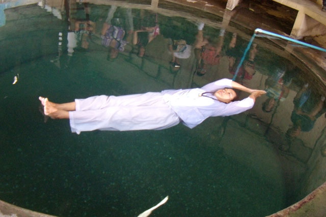 swim Buddhist nun Wat Tham Mangkon Thong, Kanchanaburi ,Thailand